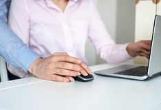 Sexual harassment at work. Man touching secretary`s hand Royalty Free Stock Photo