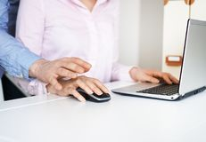 Sexual harassment at work. Man touching secretary`s hand Stock Image