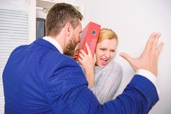 Sexual harassment in workplace. Me too social movement. Mad at colleague. stock photos
