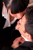 Sexual harrassment. Businessman getting tie touched by passionate woman Royalty Free Stock Images