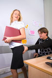 Sexual harrassment. Sexual harassment of boss in relation to secretary Stock Photos