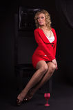 Sexual  lady in red with wine glass Royalty Free Stock Photography