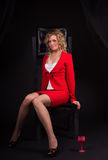 Sexual  lady in red with wine glass Royalty Free Stock Image
