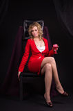 Sexual  lady in red with wine glass in a hand Royalty Free Stock Photography