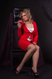 Sexual  lady in red with wine glass in a hand Stock Photography