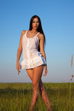 Sexual lady in the white short dress Stock Photo