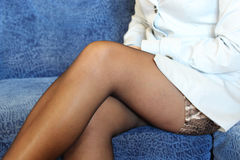 Sexual legs in black stockings of women Royalty Free Stock Image