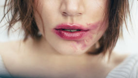 Sexual   lips with the smeared lipstick Stock Photography
