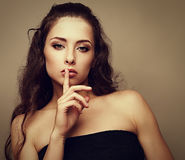 Sexual makeup woman showing silent sign Royalty Free Stock Photo