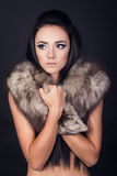 Sexual model in a fur scarf Stock Photo
