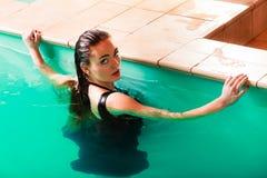 Sexual posing woman in water. Stock Image