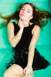 Sexual posing woman in water. Stock Photo