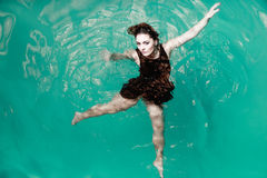 Sexual posing woman in water. Royalty Free Stock Images