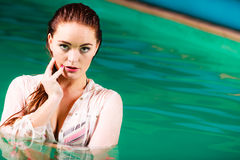 Sexual posing woman in water. Sensuality and sexuality of women. Sexual posing woman in water. Indoor Stock Photography