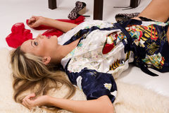 Sexual pretty girl lying on the floor Royalty Free Stock Images