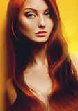 Sexual red hair adult female on yellow background Royalty Free Stock Photos