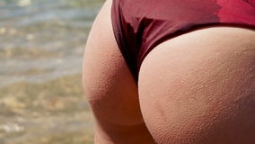 Sexual round female buttocks in red swimsuit stock video footage