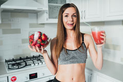 Sexual sports girl drinking a delicious smoothie with berries stock photos