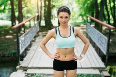 Sexual sports girl playing sports outdoors. She performs a variety of exercises Stock Photo