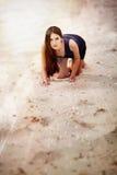 Sexual woman on the beach sand Stock Photos