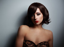 Sexual woman with black short hair looking on dark background Royalty Free Stock Images