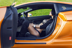 The sexual woman in car salon Royalty Free Stock Images