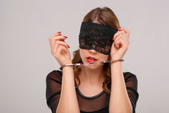 Sexual woman in eyeshade locked with handcuffs Stock Photos