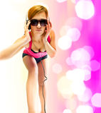 Sexual woman in headphones Royalty Free Stock Photography