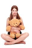 Sexual woman in a lingerie with teddy bear Royalty Free Stock Image