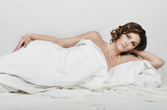 Sexual woman lying in bed Royalty Free Stock Photo