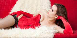 The sexual woman lying on a sofa Stock Photo