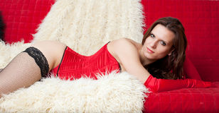 The sexual woman lying on a sofa Royalty Free Stock Photo