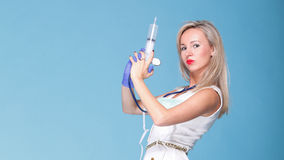 Sexual woman in nurse suit with syringe blue Royalty Free Stock Photos