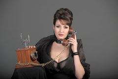 The sexual woman speaking by phone Stock Images