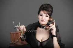 The sexual woman speaking by phone Royalty Free Stock Photo