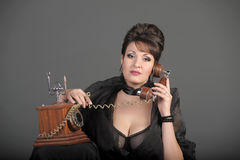 The sexual woman speaking by phone Royalty Free Stock Photos