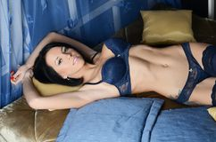 Sexual woman in underwear on a bed Stock Images