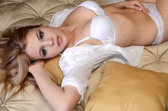 The sexual woman in underwear on a bed Royalty Free Stock Images