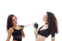 Sexual young babes posing with chain, close-up. Sexual young babes posing with chain isolated on white, close-up stock photography