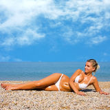 Beautiful Girl Relaxing on the Beach Royalty Free Stock Image