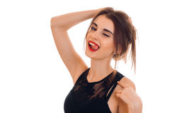 Sexual young brunette woman with red lips seduce with her tonque and winking isolated on white background. Sexual young brunette woman with red lips seduce with Royalty Free Stock Images