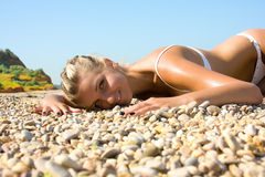 Sexual young girl Relaxing on a beach Royalty Free Stock Images