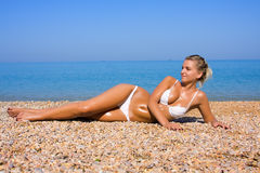 Sexual young girl Relaxing on a beach Royalty Free Stock Image