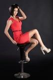 Girl on a bar chair Stock Photography