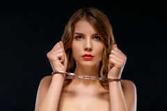 Sexual young woman locked in handcuffs Stock Photos