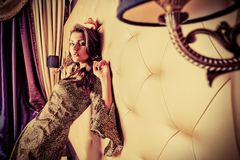 Indoor woman. Sexual young woman in a  luxurious classic interior Royalty Free Stock Photos