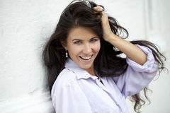 Sexual young woman. Young Brunette in white shirt stock photo