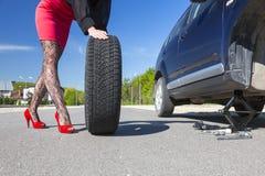 Sexually dressed woman repairing car Stock Image