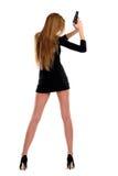 Sexuelles Mädchen mit einer Pistole Lizenzfreie Stockfotografie
