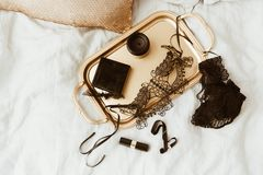 Sexy Accessories for woman. Black items on gold tray. Glamour Luxury concept. Flat Lay Stock Photography